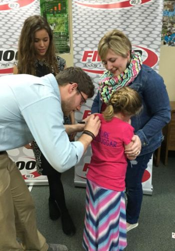 "Yes, Ben is signing the little girls' shirt, which reads ""Future Mrs. Duggar."" And, yes, it's mildly creepy..."