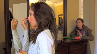 The producer wants to jam that mascara in Farrah's eye so bad!