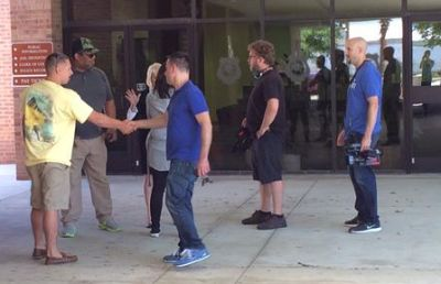 The MTV camera crew is seen standing outside the police department.
