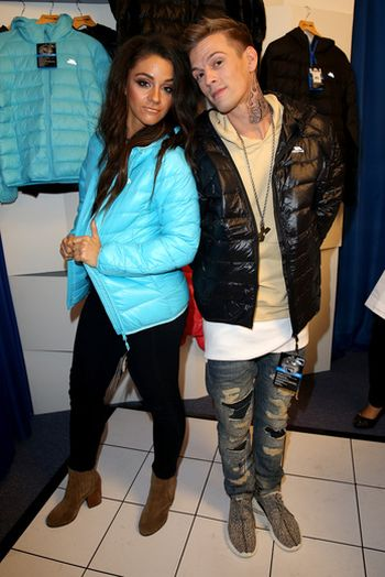 Aaron Carter and dancer Lee Karis in their new jackets.