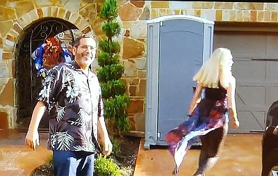 Michael stands proudly in front of the new Porta-Potty sculpture in Farrah's yard...