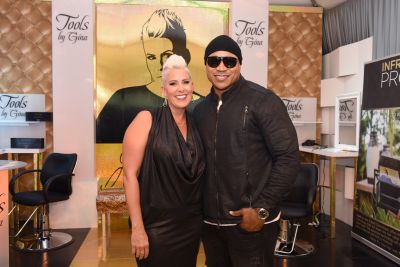 LL Cool J poses inside the Tools by Gina booth.