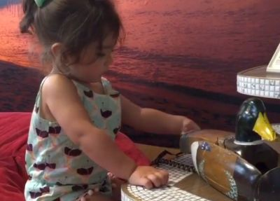 JWoWW's daughter Meilani plays with the house's famous duck phone...