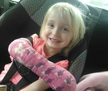 Kaitlyn proudly shows off her camo-print cast...